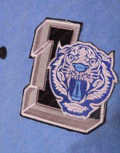 justin foley jacket logo