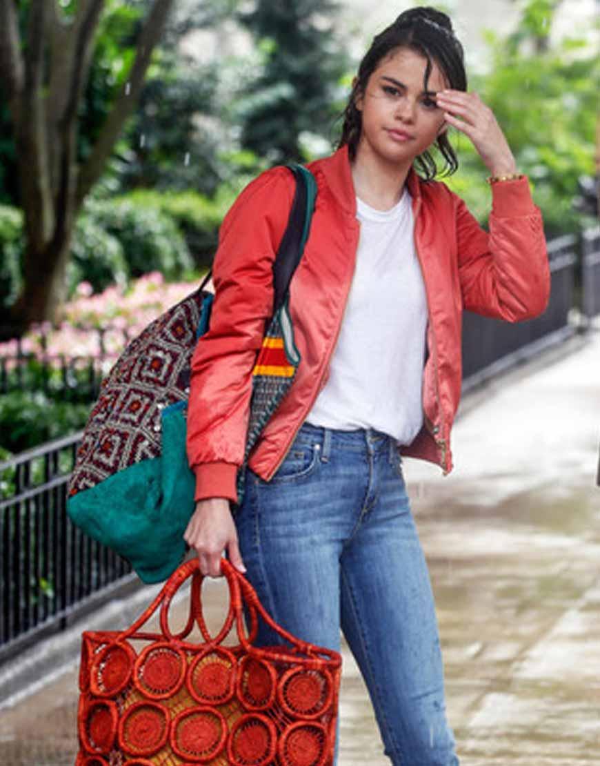selena-gomez-orange-bomber-jacket