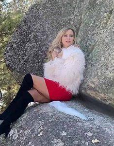 Olivia-Dunkley-It-Isn't-Christmas-Mom-White-Fur-Coat