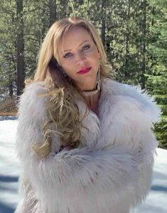 Olivia-Dunkley-It-Isn't-Christmas-White-Fur-Coat