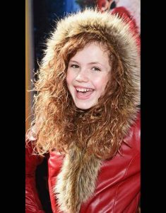 The-Christmas-Chronicles-2-Darby-Camp-premiere-Coat