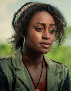 Behind-Her-Eyes-2021-Simona-Brown-Green-Jacket